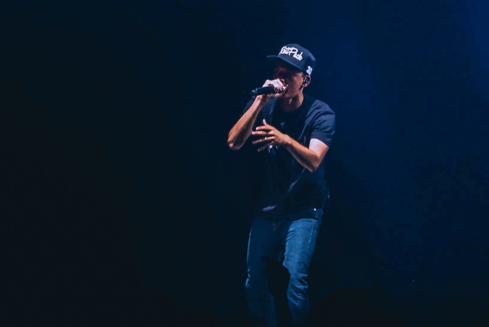 rapper on stage performing